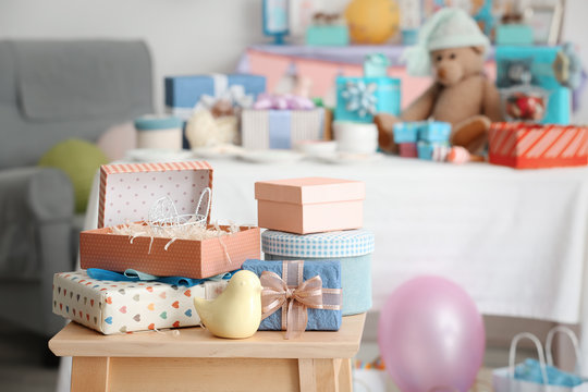 Gifts for baby shower on stool indoors