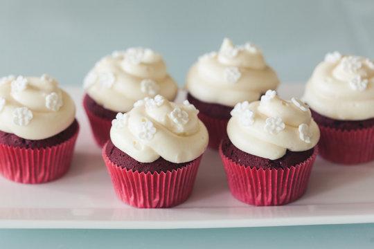Plate of red velvet cupcakes
