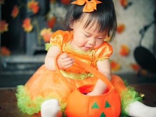 happy baby girl get her halloween candy Wall mural