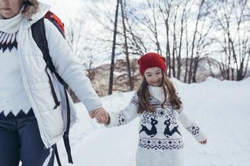 Family taking a walk on snow