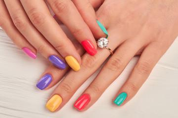Foto auf Leinwand Maniküre Manicured fingers touching diamond on ring. Engagement ring on female manicured hand. Wedding ring on woman finger.