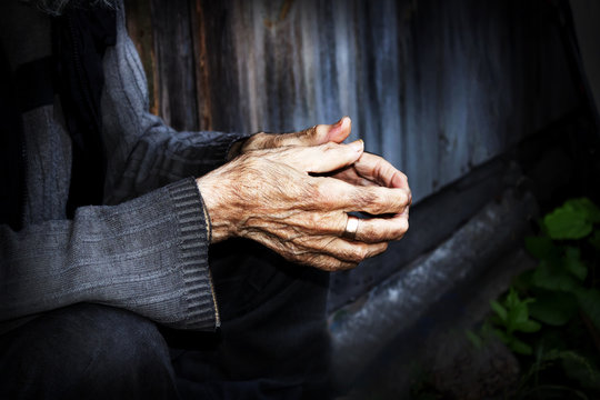 Hands are very elderly. Wrinkled hands of old men. The concept o