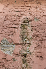 Badly damaged pink wall