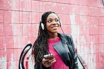 Young african woman enjoying music