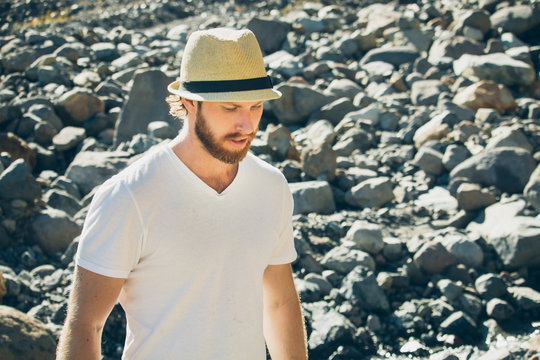 Blond Man With Beard Wearing Fedora And Looking Down