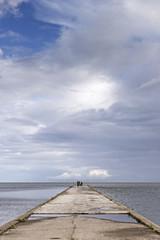 Stone pier leading into the sea