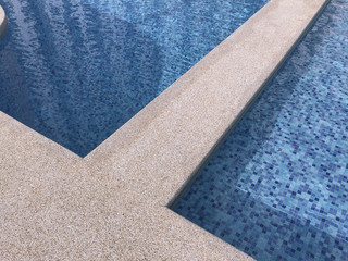 Swimming pool background pattern with blue tiles