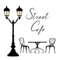Street cafe - table, chairs, streetlight and lettering City life Cityscape card view