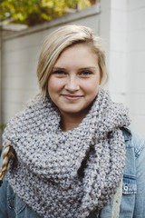 Beautiful young woman wearing grey knit scarf