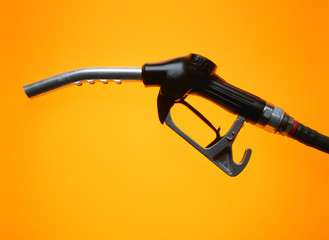 Petrol pump on yellow background