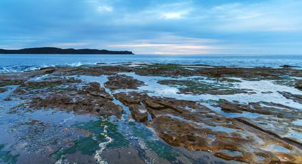 Cloudy Dawn Seascape with Rock Shelf