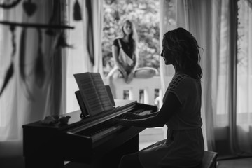 Beautiful woman playing piano. Black and white