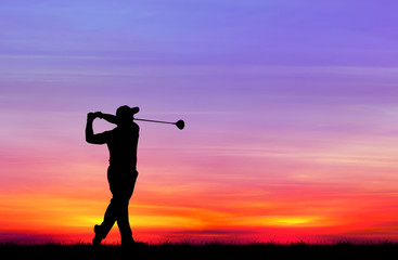 Wall Murals Golf silhouette golfer playing golf during beautiful sunset