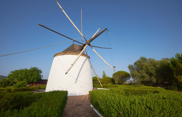 Spoed Fotobehang Molens Old traditional windmill on the hill near El Granado in Andalusia, Spain