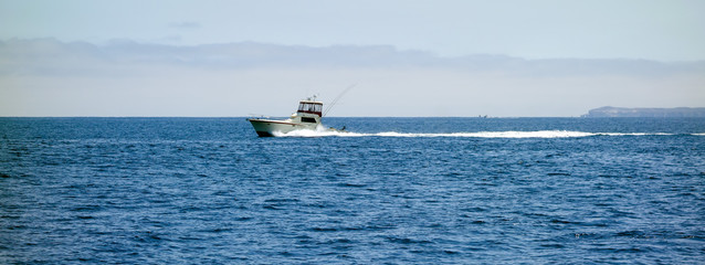 Fast moving fishing boat near Channel Islands west of Ventura coast, Southern California