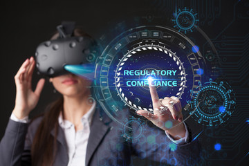 Young businesswoman working in virtual glasses, select the icon REGULATORY COMPLIANCE on the virtual display.