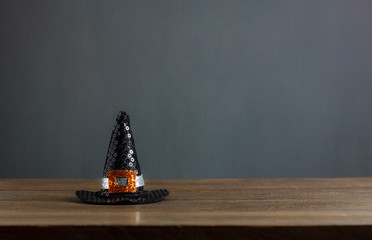 Happy Halloween decorations festival concept background.The hat of witch on modern rustic brown wooden at table home office.free space for creative design text and word.