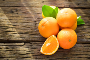Fresh orange fruits on wood table.