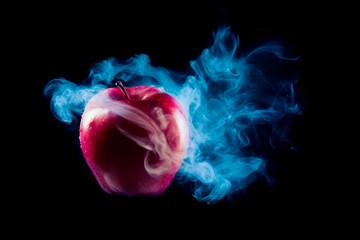 poisoned apple with dramatic lighhting on a black background