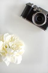Black camera on the white background