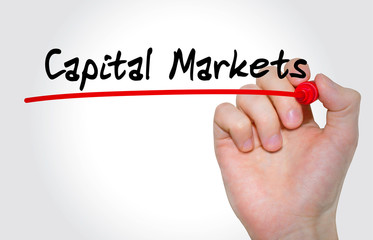 Hand writing inscription Capital Markets with marker, concept