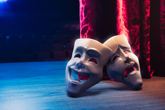 Theater masks, drama and comedy with a red curtain / 3D Rendering, Mixed media.