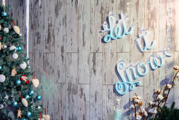 Christmas background with the inscription Let it snow. Toning