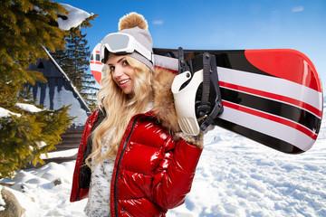 blonde snowboarder on snow