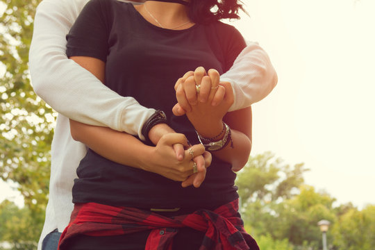 Couple in love holding hands.