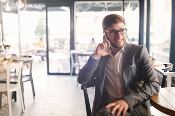 Businessman wearing glasses talking on phone