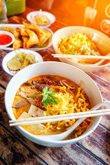 Northern Thai curried noodle soup with chicken meat and spicy coconut milk (Khao Soi Kai)
