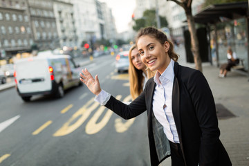 Businesswoman waving for a cab
