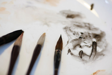 Paint brushes are seen at the upstairs studio of the Mansudae Art Museum in the 798 art district in Beijing