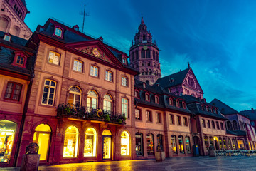 View of the Mainz Cathedral and Markt square at night. Beautiful architecture of old town in night illumination. Mainz, Rhineland-Palatinate, Germany.