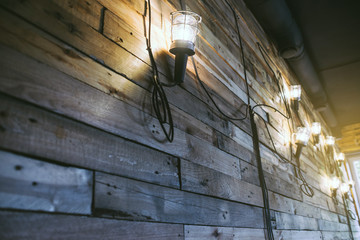 Loft styled wooden texture with lamps and lanterns