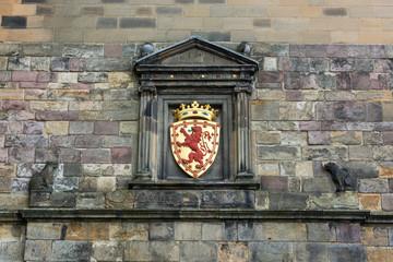 Red lion on golden emblem above the gate of Edinburgh castle
