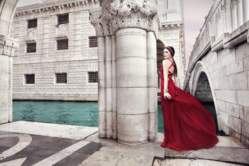 Woman in red dress in Venice, Italy