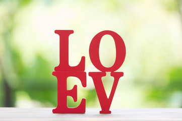 "Wooden letters word ""LOVE"" with Wooden Letter L,O,V and E on wooden table,use for Valentine day background."