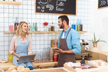 cafe owners using laptop