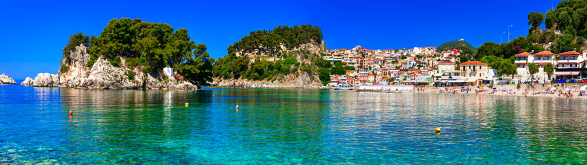 Greek holidays - sunny colorful Parga town with amazing crystal sea Wall mural