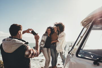 Friends on road trip taking pictures