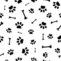 Seamless pattern of black paw prints and bones.