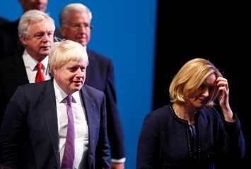 Britain's Home Secretary Amber Rudd, Foreign Secretary Boris Johnson, Secretary of State for Leaving the EU David Davis and Defence Secretary Michael Fallon arrive in the auditorium at the Conservative Party conference in Manchester