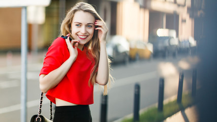 Image of smiling woman in red jacket