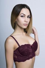 Portrait of brunette girl in bordo bra