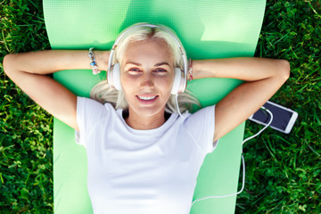 Photo of girl in headphones at lawn