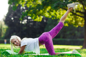 Photo of sports woman engaged in fitness