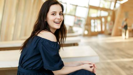 Photo of smiling girl in black dress