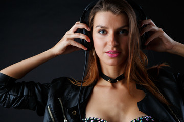 Photo of young girl in headphones and underwear