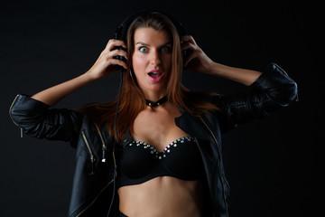 Image of young woman wearing headphones